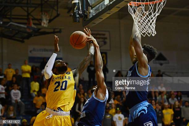 BJ Johnson of the La Salle Explorers is fouled by EC Matthews the Rhode Island Rams as teammate Cyril Langevine pressures during overtime at Tom Gola...