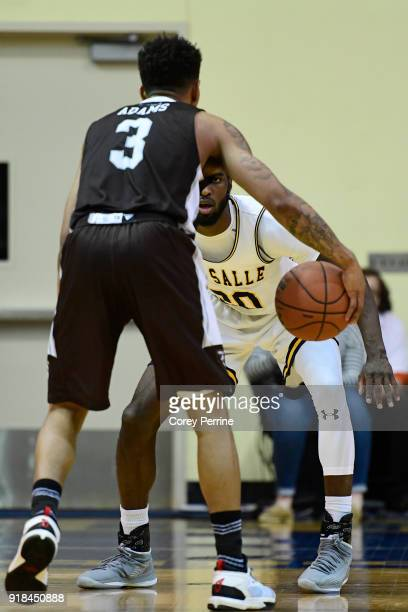 J Johnson of the La Salle Explorers looks to defend as Jaylen Adams of the St Bonaventure Bonnies dribbles during the second half at Tom Gola Arena...