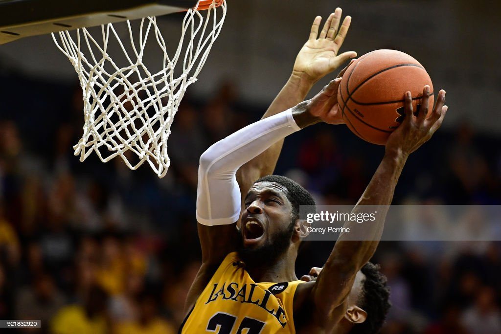 B.J. Johnson #20 of the La Salle Explorers reacts as he is fouled from behind by Nicola Akele #45 of the Rhode Island Rams during the second half at Tom Gola Arena on February 20, 2018 in Philadelphia, Pennsylvania. Rhode Island edged La Salle 95-93 in overtime.