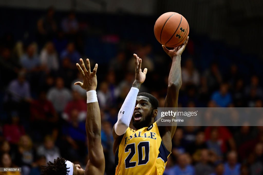 B.J. Johnson #20 of the La Salle Explorers shoots the ball over E.C. Matthews #0 of the Rhode Island Rams during the second half at Tom Gola Arena on February 20, 2018 in Philadelphia, Pennsylvania. Rhode Island edged La Salle 95-93 in overtime.