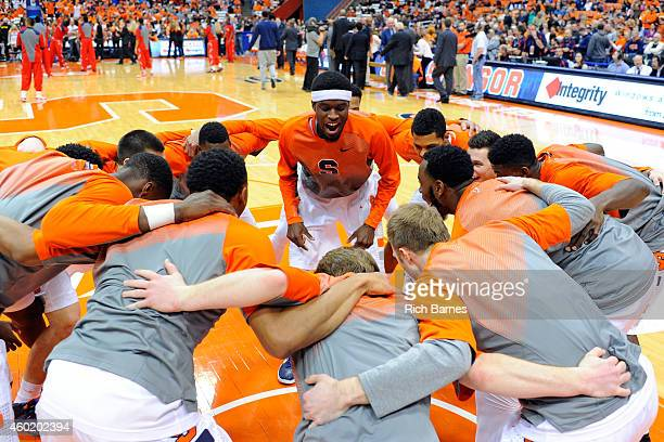 Johnson of the Syracuse Orange leads a cheer with teammates prior to the game against the St. John's Red Storm at the Carrier Dome on December 6,...