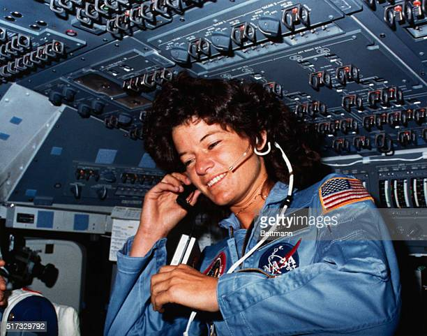 Johnson Space Center Houston Texas On board SceneAstronaut Sally K Ride STS7 mission specialist communicates with ground controllers from the flight...