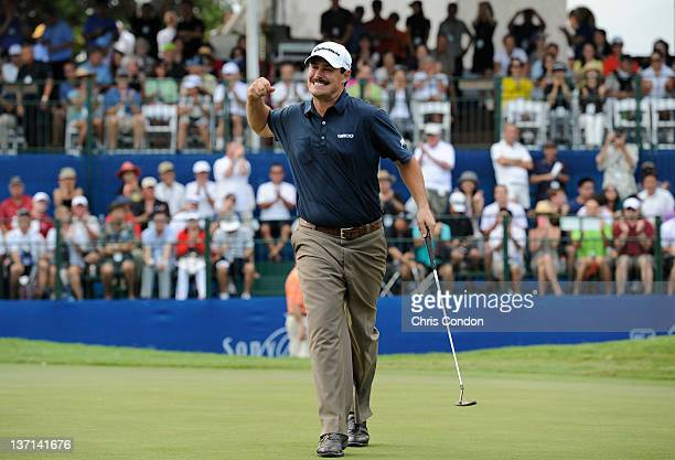 Johnson Wagner celebrates on the 18th green after winning the Sony Open in Hawaii at Waialae Country Club on January 15 2012 in Honolulu Hawaii