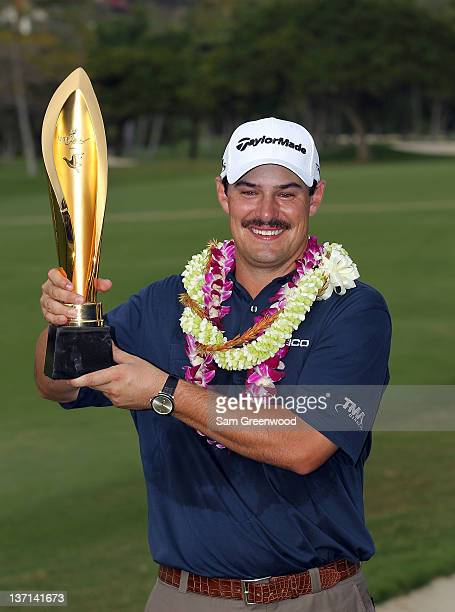 Johnson Wagner holds the trophy after winning the Sony Open in Hawaii at Waialae Country Club on January 15 2012 in Honolulu Hawaii