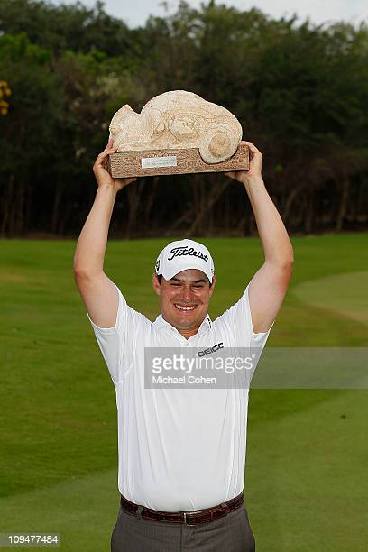 Johnson Wagner holds the trophy overhead after winning the Mayakoba Golf Classic at Riviera MayaCancun held at El Camaleon Golf Club on February 27...