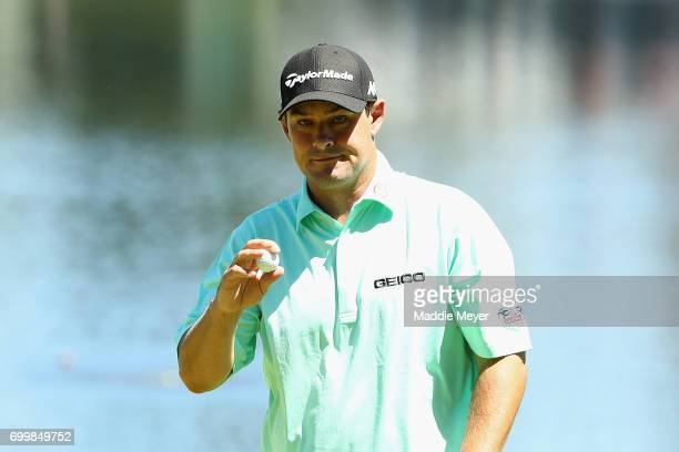 Johnson Wagner of the United States reacts after putting on the 16th green during the first round of the Travelers Championship at TPC River...