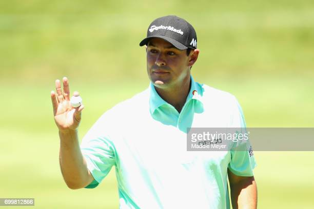 Johnson Wagner of the United States reacts after putting on the 17th green during the first round of the Travelers Championship at TPC River...