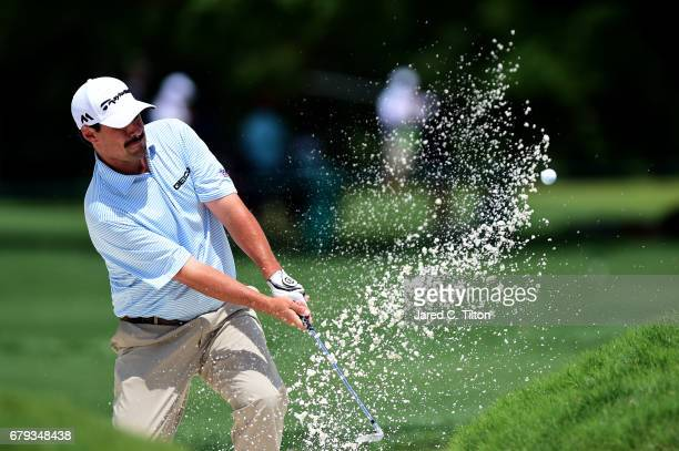 Johnson Wagner plays a shot from a bunker on the tenth hole during round two of the Wells Fargo Championship at Eagle Point Golf Club on May 5 2017...