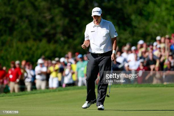 Johnson Wagner reacts after a birdie on the 18th hole during round three of the Greenbrier Classic at the Old White TPC on July 6 2013 in White...