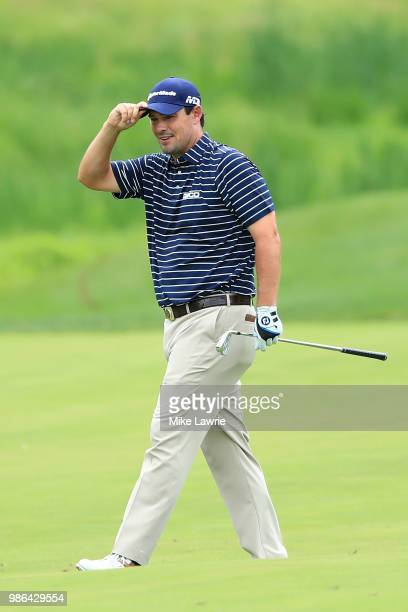Johnson Wagner reacts after a shot on the sixth fairway during the first round of the Quicken Loans National at TPC Potomac on June 28 2018 in...