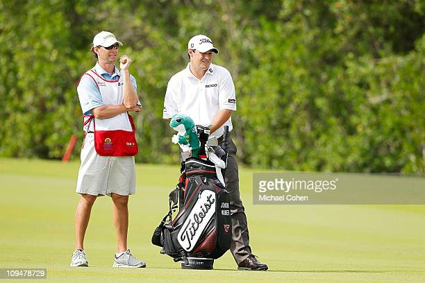 Johnson Wagner stands next to his caddie on the 13th fairway during the final round of the Mayakoba Golf Classic at Riviera MayaCancun held at El...