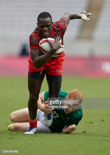 Johnstone Olindi of Kenya and Gavin Mullin of Ireland battle for the ball during the Rugby Pool c match between Kenya and Ireland on day four of the...