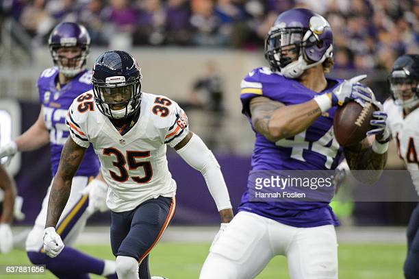 Johnthan Banks of the Chicago Bears watches as Matt Asiata of the Minnesota Vikings catches the ball during the game on January 1 2017 at US Bank...