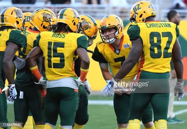 John Wolford of the Arizona Hotshots speaks to teammates before the start of the Alliance of American Football game against the Atlanta Legends at...