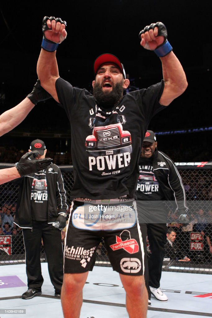 Johny Hendricks celebrates after defeating Josh Koscheck in their Welterweight bout at Izod Center on May 5, 2012 in East Rutherford, New Jersey.