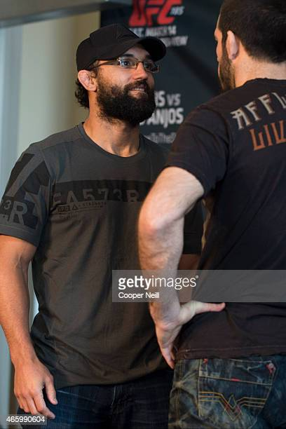 Johny Hendricks faces off with Matt Brown during the UFC 185 Ultimate Media Day at the American Airlines Center on March 12 2015 in Dallas Texas