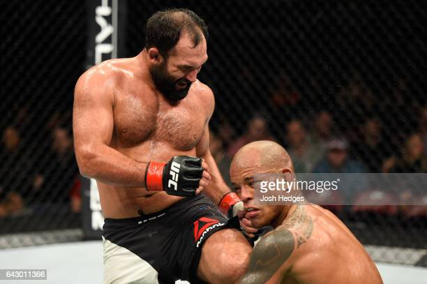Johny Hendricks lands a knee to the head of Hector Lombard of Cuba in their middleweight fight during the UFC Fight Night event inside the Scotiabank...