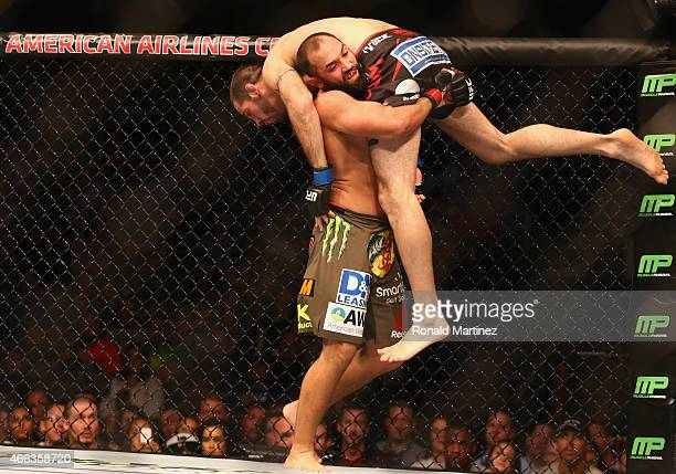 Johny Hendricks lifts Matt Brown in the Welterweight bout during the UFC 185 event at American Airlines Center on March 14 2015 in Dallas Texas