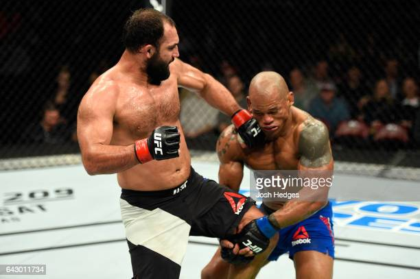 Johny Hendricks punches Hector Lombard of Cuba in their middleweight fight during the UFC Fight Night event inside the Scotiabank Centre on February...