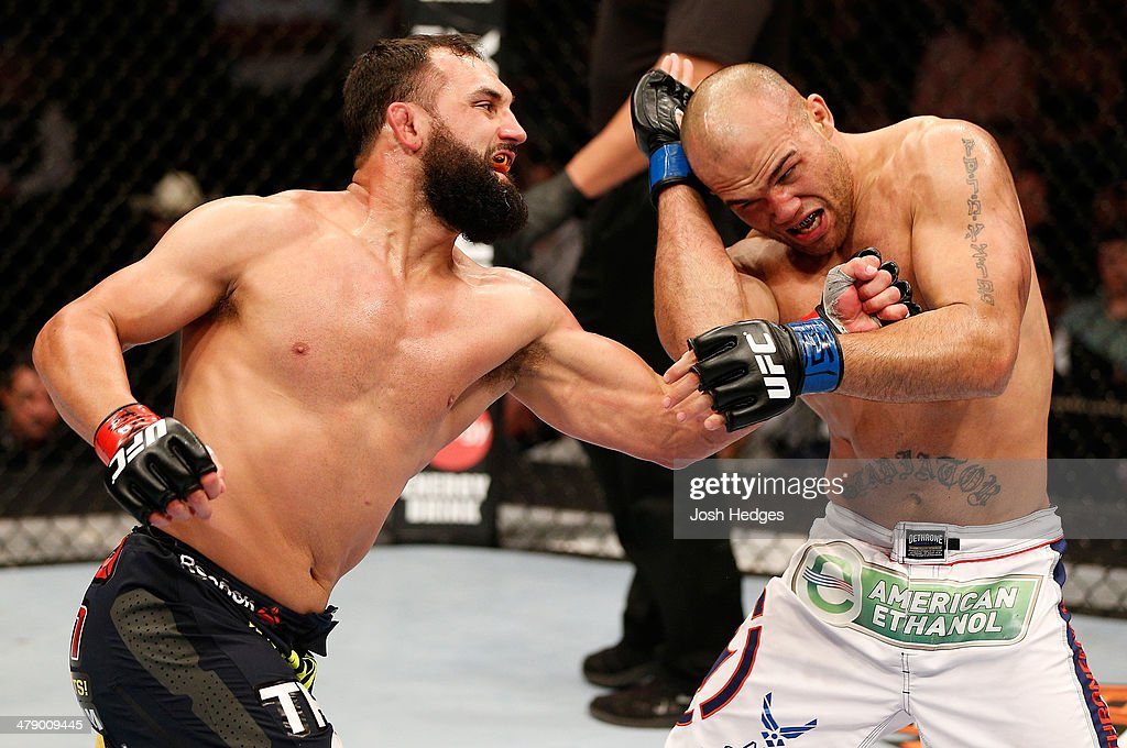 Johny Hendricks punches Robbie Lawler in their UFC welterweight championship bout at UFC 171 inside American Airlines Center on March 15, 2014 in Dallas, Texas.