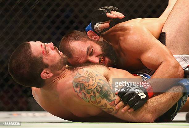 Johny Hendricks top fights with Matt Brown in the Welterweight bout during the UFC 185 event at American Airlines Center on March 14 2015 in Dallas...