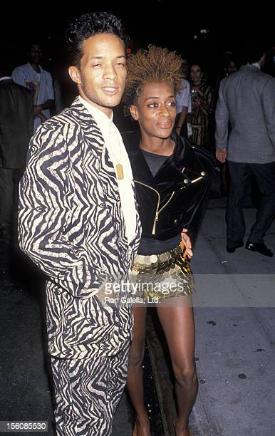 Joi Lee and date attending the premiere of 'Mo' Better Blues' on July 23 1990 at the Ziegfeld Theater in New York City New York