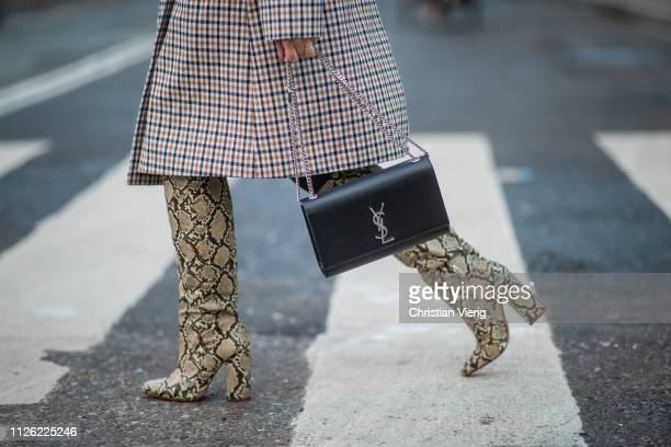 Joicy Muniz is seen wearing coat Selected Femme skirt By Malene Birger YSL bag Zara boots with snake print during the Copenhagen Fashion Week...
