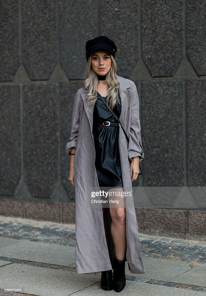 Joicy Muniz wearing a grey trench coat and black leather dress outside Lala Berlin during the first day of the Copenhagen Fashion Week Spring/Summer 2017 on August 10, 2016 in Copenhagen, Denmark.