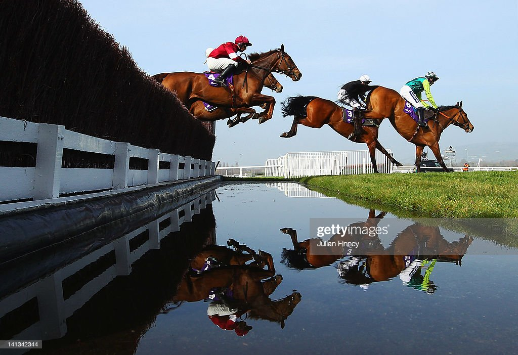 Join Together ridden by Ruby Walsh, Cannington Brook ridden by Joe Tizzard and First Lieutenant ridden by Davy Russell clear the water jump in the RSA Steeple Chase during day two of the Cheltenham Festival at Cheltenham Racecourse on March 14, 2012 in Cheltenham, England.