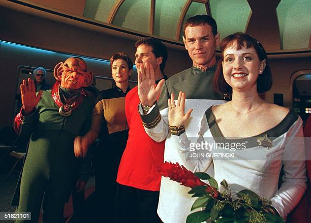 Joined by Ferengis, Klingons and Starfleet crew members, Star Trek fans Mikel and Craig Salsgiver display the Vulcan greeting after renewing their...