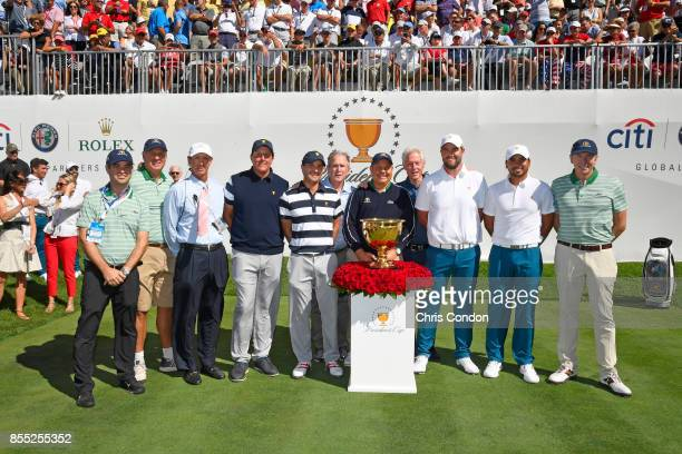 Joined by former Presidents George W Bush and Bill Clinton Phil Mickelson and Kevin Kisner of the US Team stand alongside Marc Leishman and Jason Day...