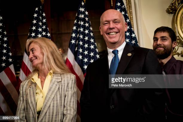 Joined by his wife Susan and son Adam controversial Montana Republican Greg Gianforte speaks to the media as he waits to be ceremonially sworn in by...