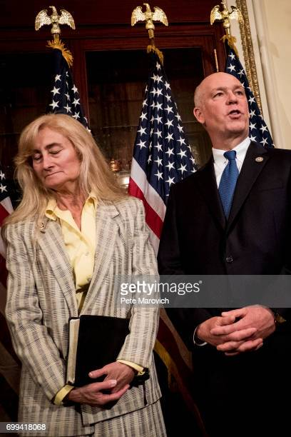 Joined by his wife Susan controversial Montana Republican Greg Gianforte speaks to the press before he is ceremonially sworn in by Speaker of the...