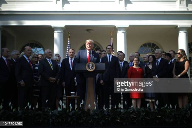 Joined by members of his cabinet and employees from the office of the US Trade Representative President Donald Trump speaks during a press conference...