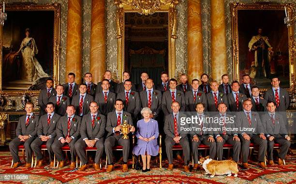 Joined By One Of Her Pet Corgis The Queen Poses With The England Rugby Squad At Buckingham Palace To Celebrate The Rugby World Cup Win Front Row Matt...