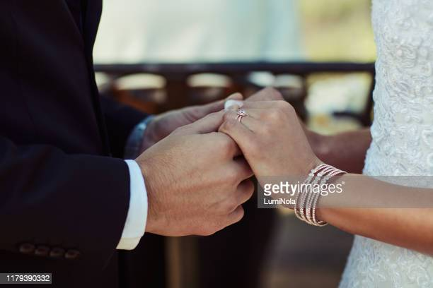 joined in holy matrimony - wedding reception stock pictures, royalty-free photos & images