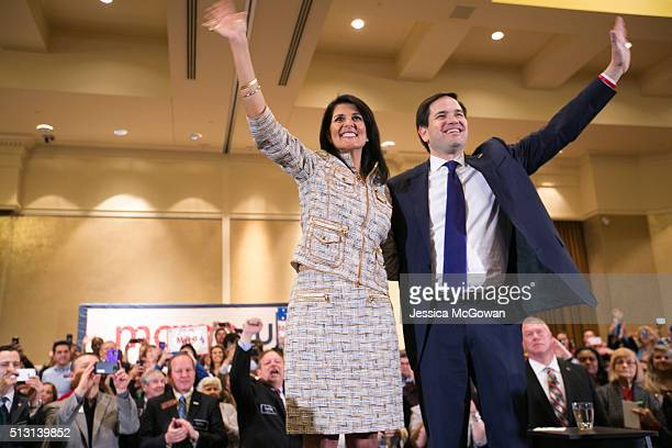 Joined on the stage with South Carolina governor Nikki Haley Republican presidential candidate Marco Rubio waves to supporters during a campaign...