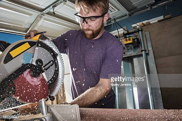 Joiner in garage using circular saw