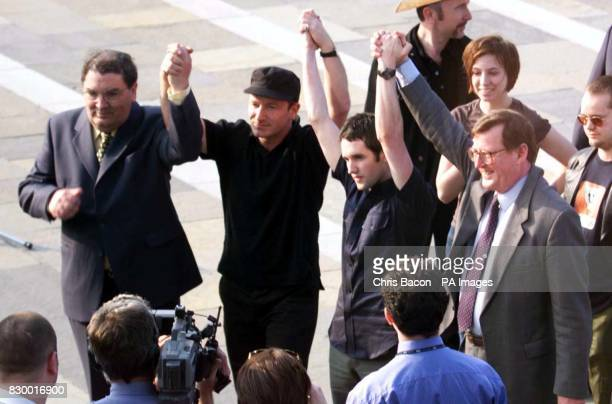 Joining hands for a 'YES' vote in the forthcoming Northern Ireland Referendum are SDLP leader John Hume Irish rock stars Bono of the band U2 and Tim...