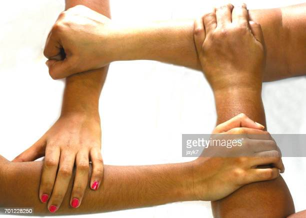 joining hands - social justice concept stock pictures, royalty-free photos & images