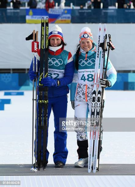 Joint 3rd placed Marit Bjoergen of Norway and Krista Parmakoski of Finland celebrate following the CrossCountry Skiing Ladies' 10 km Free on day six...