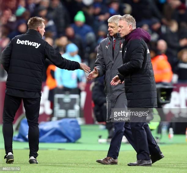 LR Joint Assistant Manager Stuart Pearce shanks hands with Arsenal manager Arsene Wenger and West Ham United manager David Moyes during Premier...