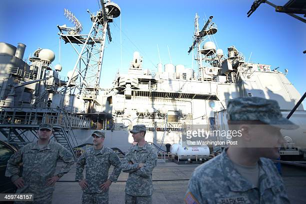Joint Base Pearl HarborHickam Army personnel wait dockside to board the USS Lake Erie CG70 a Ticonderoga class United States Navy guided missile...