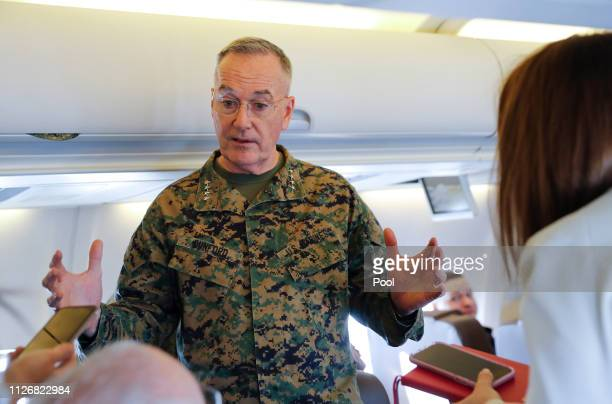 Joint Chiefs Chairman Gen Joseph Dunford gestures while speaking to reporters during a briefing on a military aircraft before arrival at El Paso...