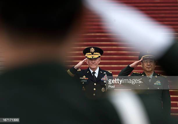 Joint Chiefs Chairman Gen Martin Dempsey and Chinese counterpart Gen Fang Fenghui salute during a welcoming ceremony at the Bayi Building on April 22...