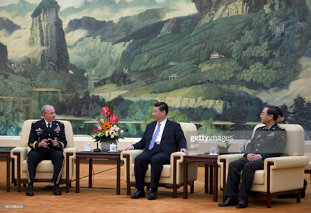 US Joint Chiefs Chairman General Martin Dempsey (L) chats to Chinese President Xi Jinping (C) and Chinese Chief of the General Staff Gen. Fang Fenghui (R) during their meeting at the Great Hall of the People in Beijing on April 23, 2013. Dempsey was expected to discuss concerns over tensions with North Korea, amongst other bilateral items. AFP PHOTO / POOL / Andy Wong