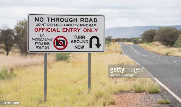 Joint Defence Facility street sign on the side of the road stating 'no photography from the point on turn around now' on January 12 2018 in Alice...