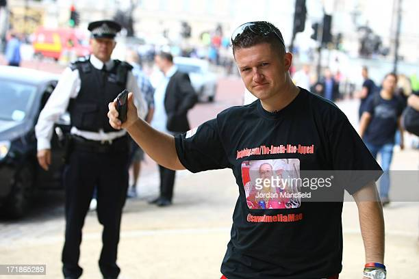 Joint EDL leader Tommy Robinson gestures to a police officer on June 29 2013 in London England The leaders of the English Defence League Tommy...