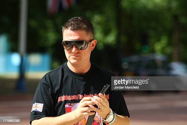 Joint EDL leader Tommy Robinson walks along the Mall on June 29 2013 in London England The leaders of the English Defence League Tommy Robinson and...