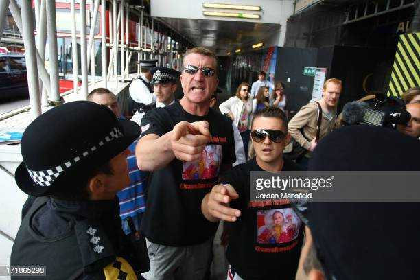 Joint EDL leaders Kevin Carroll and Tommy Robinson are arrested by police on June 29 2013 in London England The leaders of the English Defence League...